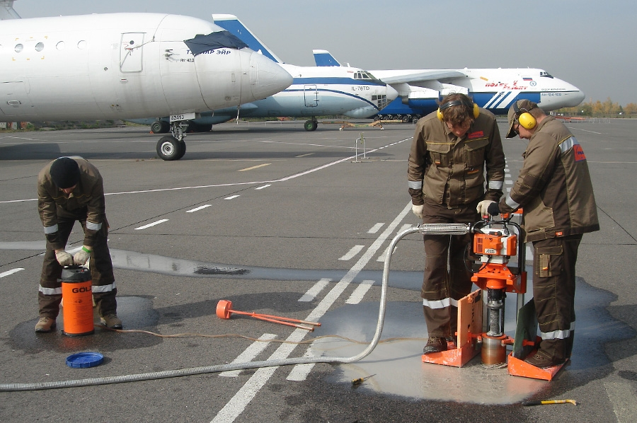Taking core samples of airfield pavements
